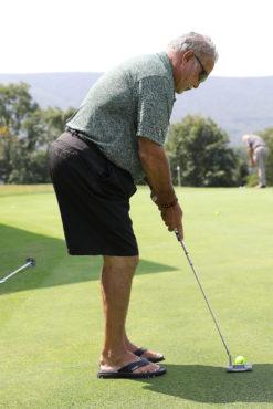 Golfer taking a putt