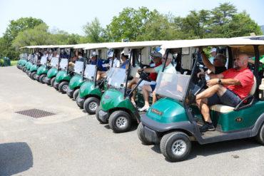 Golfers sitting in carts