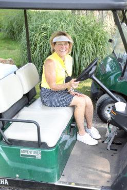 Golf volunteer in cart